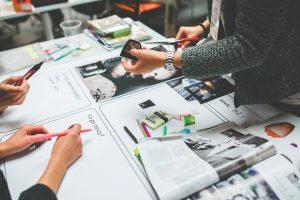 graphic design team creating a master piece